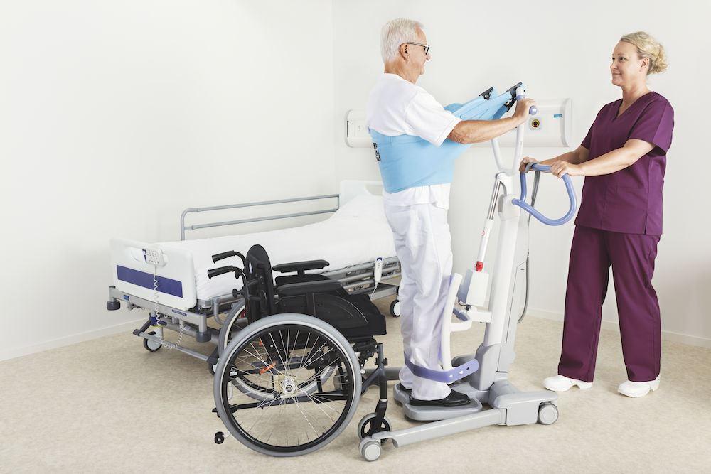 Elderly man using SARA Flex to stand