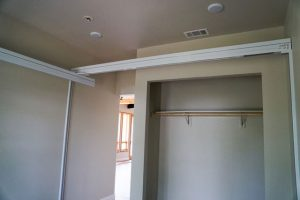 Wall to Wall Brackets are used where there is no attic access and the lift must be able to bear a weight of 600 lbs. The Wall Posts are attached to the wall studs using a higher capacity fixed track attached to the tops of the Wall Posts. The room shown has an X-Y System.